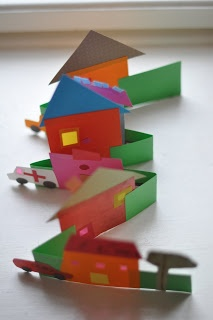 a little: Street in town. Cut and glue cardboard houses on zigzag street.