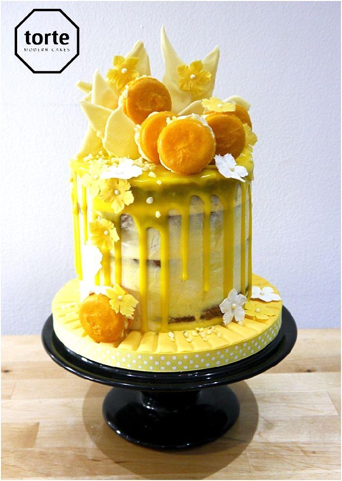 Sunshine semi-naked birthday cake #yellow #birthday #cake #macarons #nakedcake #website