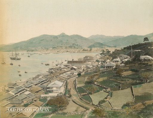 1870's, Nagasaki.  A view on Nagasaki Harbor and the southern tip of the city's foreign settlement. The main settlement in Oura is behind the hill in the right background. The lone pine tree located on that hill marks the location of the residence of the influential Scottish merchant Thomas Blake Glover (1838-1911). The house was completed in 1863 (Bunkyu 3) and is today the oldest extant Western-style building in Japan.