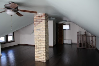 our attic has chimney in the middle of it too.