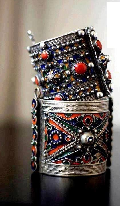 Jewelry from Great Kabylia, Algeria, has a very distinctive style. Intricate patterns are combined with colourful enameled  ornaments and coral beads. The bright blue, yellow and green applied in small compartments makes this jewelry appear rich and decorative.