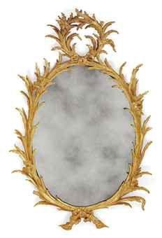 A GEORGE III GILTWOOD OVAL MIRROR  1760