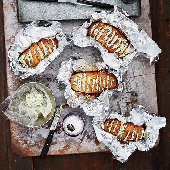 Grill-Baked Potatoes with Chive Butter. Via T+L  (www.travelandleisure.com).