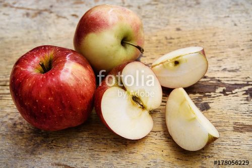 """Download the royalty-free photo """"Bio apples with slice on rustic wooden background. Autumn fruits"""" created by stillforstyle at the lowest price on Fotolia.com. Browse our cheap image bank online to find the perfect stock photo for your marketing projects!"""