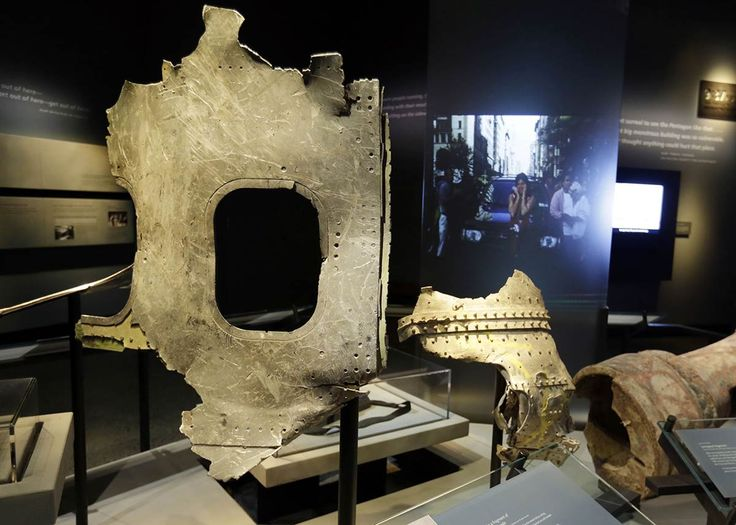 Inside the 9/11 Museum-Airplane parts Fragments of the fuselage of Flight 11, which hit the World Trader Center. In all, 76 passengers and 11 crew members aboard American Airlines Flight 11 perished when the jet crashed into the North Tower at 8:46 a.m. on Tuesday, Sept. 11, 2001. And 51 passengers and nine crew members died when United Airlines Flight 175, slammed into the South Tower at 9:03 a.m. Both flights were on their way to LA