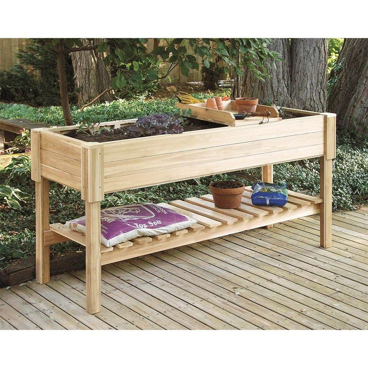 cedar raised garden center -- idea not price (could put indoors plants on top get sun, and put grow lights under trough for plants on bottom shelf)