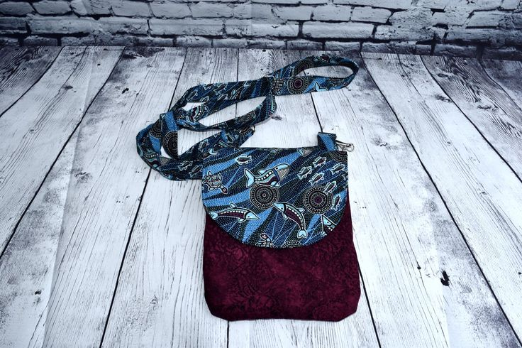 Bag that Xaria made in a test photo shoot using new backdrop fabric hung and draped over freezer... made a very simple frame to hold it (with 2 clamps)...  Will have to Iron the fabric and it will have to be on very low heat because the type of fabric it is.  But I think the effect works well
