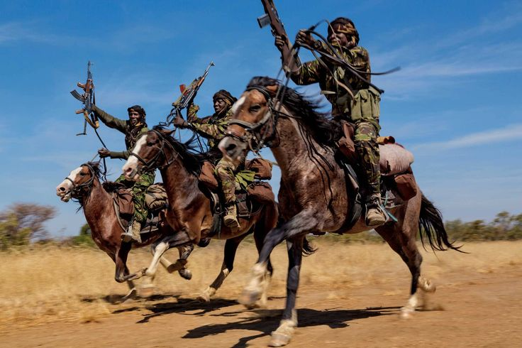 <b> From the September issue of National Geographic magazine: <i>Tracking Ivory:  Terror in Africa</i></b><br> Rangers practice their riding skills at Zakouma National Park, in Chad. The park has four mounted ranger teams because horses are the only way to effectively patrol during the wet season, when the elephants head to drier land outside the park.
