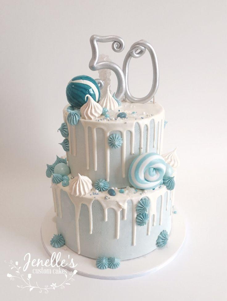 Blue drip cake. By Jenelle's Custom Cakes.