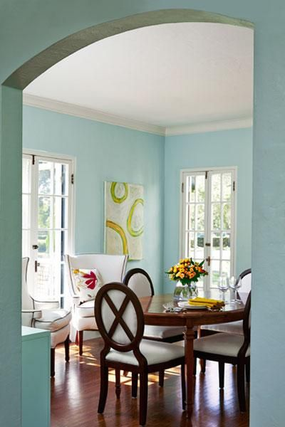 Three sets of restored French doors flood this high-ceilinged dining room and its new oak flooring with light.   Photo: Deborah Whitlaw Llewellyn   thisoldhouse.com