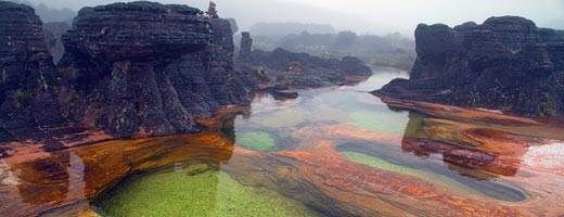 Hot springs on Mount Roraima, Venezuela - Mount Roraima sits mainly in Venezuela, but the wedge-shaped plateau acts as a border between Brazil and Guyana as well. Most who make the ascent approach from the ramp-like route on the Venezuelan side, though a few brave climbers have scaled the sheer, 1,300-foot cliffs that dominate the Brazilian and Guyanese faces of the peak. Natural jacuzzi-like pools top the summit.