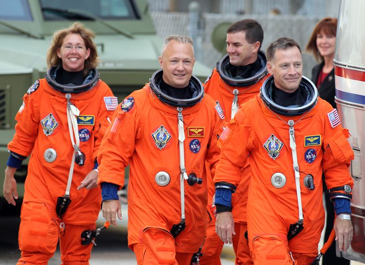 Space shuttle Atlantis astronauts (right to left) Commander Chris Ferguson, Rex Walheim, Pilot Doug Hurley, and Mission Specialist Sandra Magnus are seen boarding their transport on July 8, 2011 at Kennedy Space Center. (STR/AFP/Getty Images) #