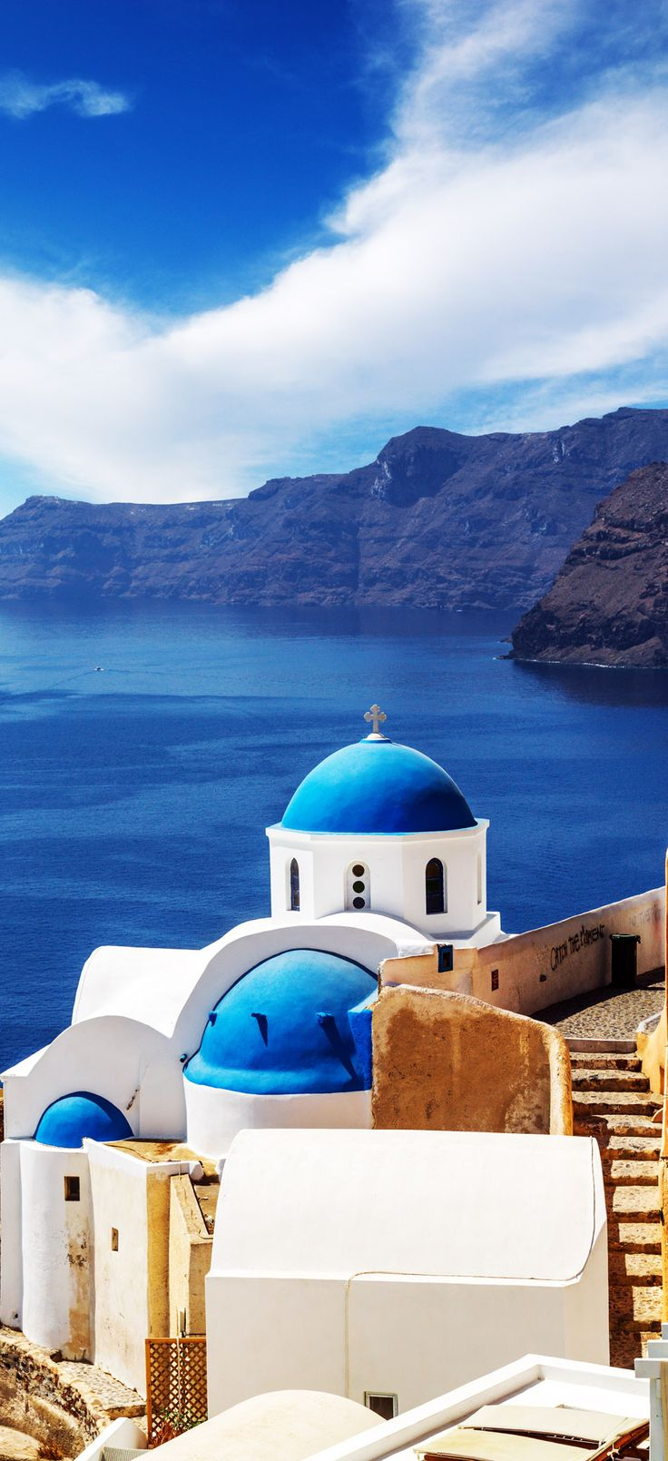 Churches of Oia village under puffy clouds, Santorini island, Greece | 10 Breathtaking Photos of World's Most Romantic Island