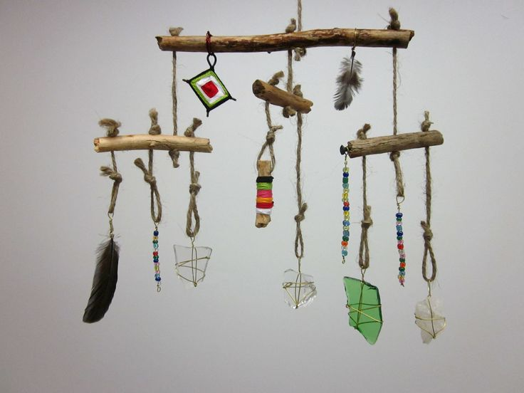 Found object mobile.  This would be a fun way to displayu natural and unnatural objects that the kids admire.  Better than putting it all on the dresser.  Simple with wood, string, and items.