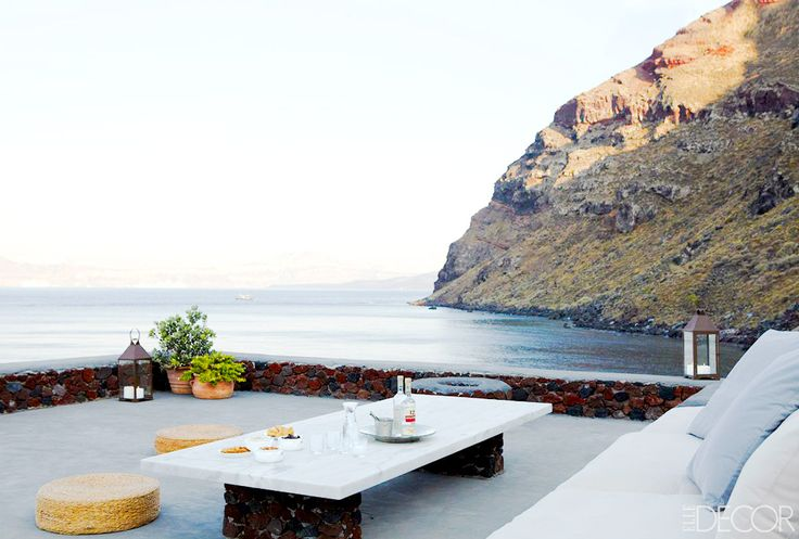 Outdoor dining space in Santorini with an ocean view.  Thirassia, Santorini island, Greece. - selected by www.oiamansion.com