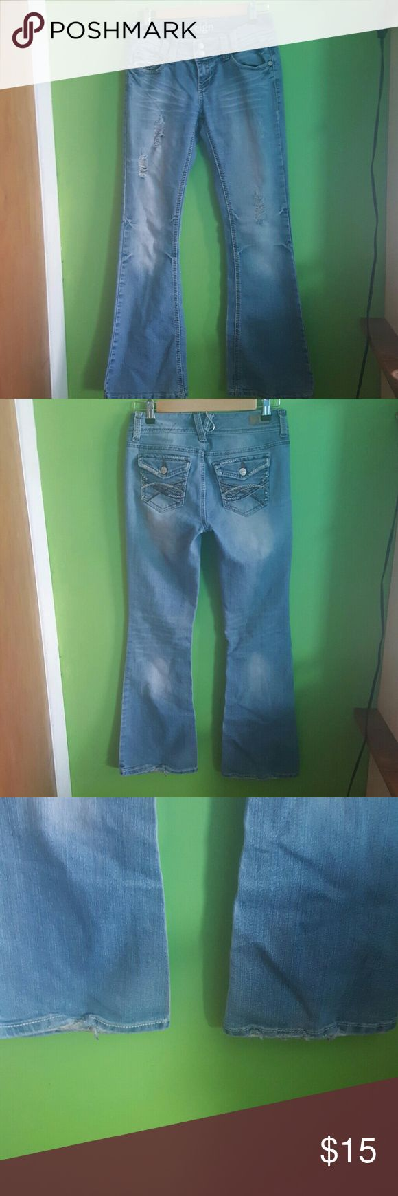 Reign jeans curvy fit Distressed light jeans. Curvy fit, great for every day. Some wear one heels (pictured), but overall good condition. BOGO! Buy One Get One Free! Details in my closet! Reign Jeans Flare & Wide Leg