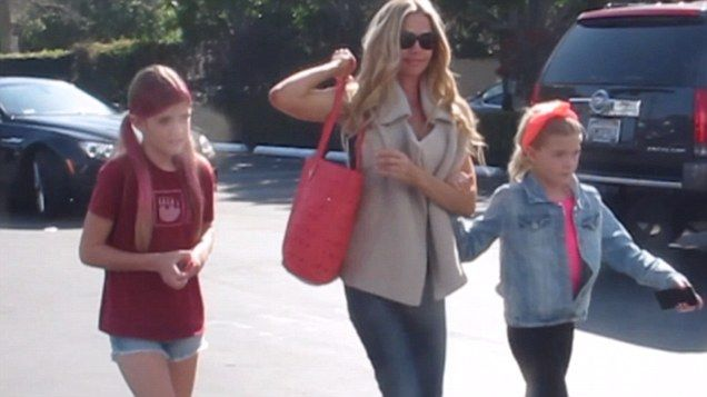 Denise Richards takes her daughters shopping earlier this year in West Hollywood.