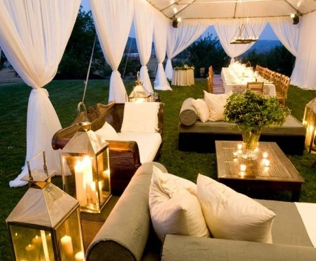 Beautiful seating areas. Open sided marquee, lights, lanterns and planters.
