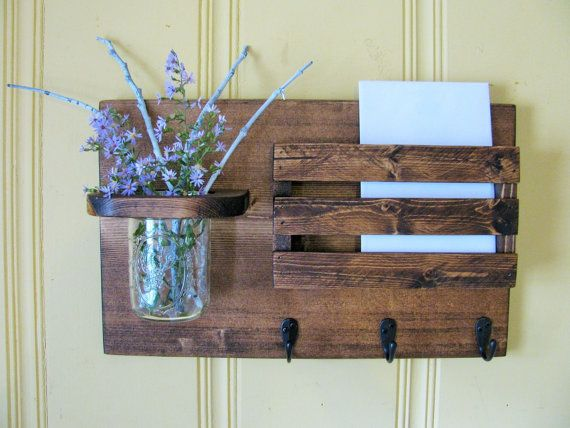 This mail organizer is perfect in rustic decor or country setting. Stained in dark walnut and includes pint jar and three key/robe hooks. Color may