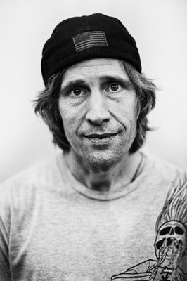 John Rodney Mullen (born August 17, 1966) is a professional skateboarder, company owner, inventor, and public speaker who practices freestyle and street skateboarding. Mullen is credited with inventing numerous skateboarding tricks, including the flatground ollie, kickflip, heelflip, impossible, and 360-flip (or Tre-flip).