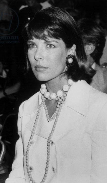 Beautiful & Elegant Princess Caroline of Monaco wearing Chanel, her Handsome husband Stefano Casiraghi (Italian Businessman & World Speedboat Champion) sitting behind her at a Chanel Fashion Show July 26, 1989.