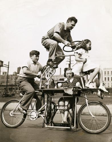 Family on Four Position Bicycle- Bettman/ Corbis