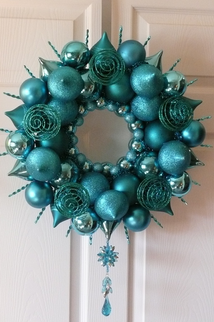 """My """"Burst of Turquoise Sunshine"""". All it took was a styrofoam wreath form from Michael's, Christmas balls and fillers and that ever handy glue gun."""