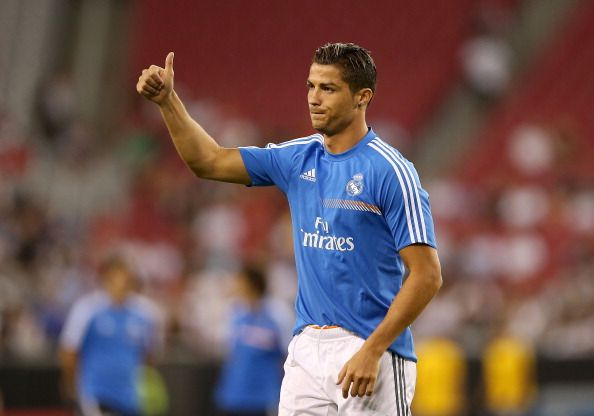 Cristiano Ronaldo #7 of Real Madrid waves to fans before the International Champions Cup match against the Los Angeles Galaxy at University of Phoenix Stadium on August 1, 2013 in Glendale, Arizona
