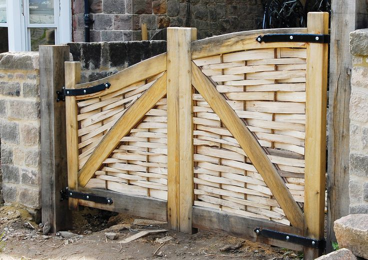 Gate crafted from green Oak with panels woven from Hazel lath, fitted with handmade ironmongery from a local forge. We design and make gates to provide a unique entrance for your home, business or country park.