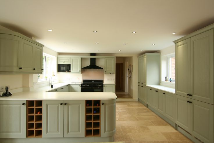 Oak wine racks in peninsular, Belling Range cooker and Black hood, with Bosch Microwave.