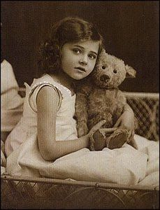 What a lovely old photo of a girl and her teddy bear!