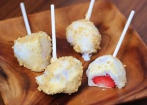 frozen yogurt strawberries pops. So going to do it with bananas and chocolate too. Great idea for the summer!! by joy