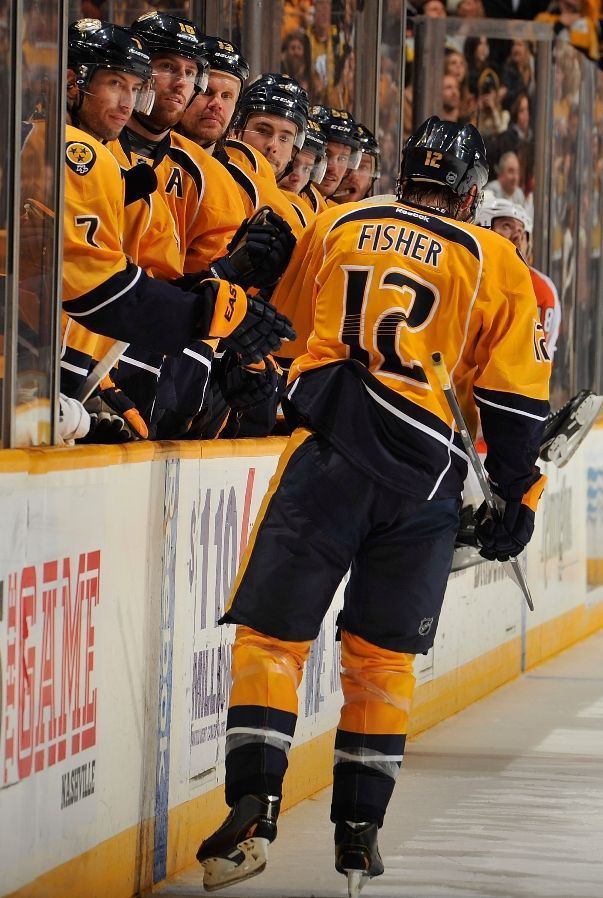 Mike Fisher #12 of the Nashville Predators is congratulated by teammates on scoring a goal against the Philadelphia Flyers