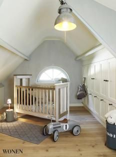 Such a great attic nursery design! Plus, we think the added storage areas to the side are a great way to utilize extra space!