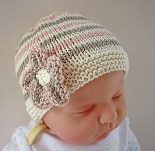 An easy to knit baby hat with a cute flower embellishment.