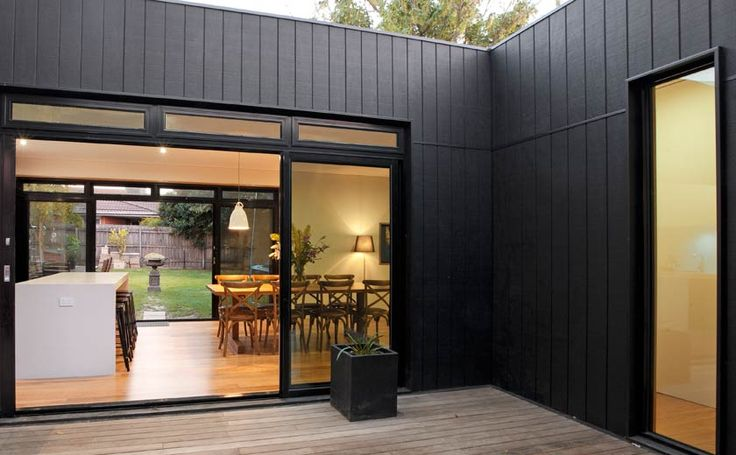 Modscape. Box Hill extension kitchen/ living opening to external deck.