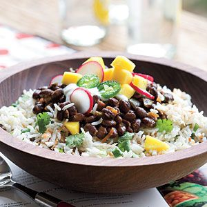 Spicy black beans over lime cilantro coconut rice. I have taken it to potlucks and it is always a hit
