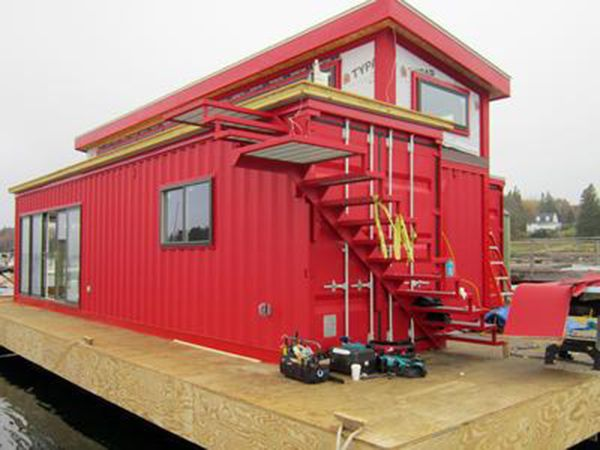 Boat builder Steve White from Belfast, Scotland has recently constructed a houseboat made from shipping containers. He intends to live in it and has parked it in the Brooklin marina. White was helped in bringing his project into existence by SnapSpace Solutions, which is a Brewer company specializing in repurposing containers for living and office space, as well as Ellsworth container homeowners Jennifer Sansosti and Trevor Seip, and boat builder Andrew Baldwin.