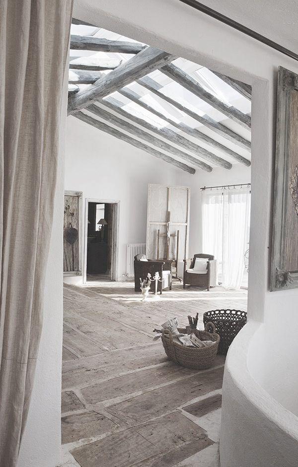 = beams and skylight and mixed flooring