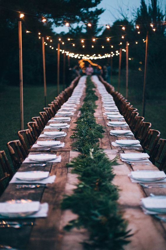 Garden dinner party… long table with simple centerpiece and lighting… chic. …