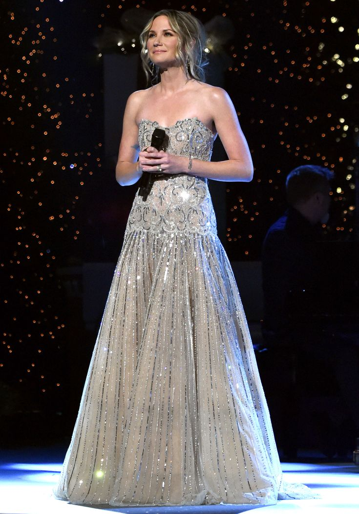 JENNIFER NETTLES wearing an embellished silver Rani Zakhem gown for a taping of a 2016 Country Christmas in Nashville, Tennessee.