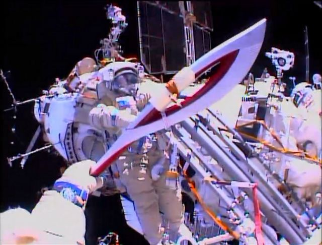 Russian Astronauts Take Olympic Torch On A Spacewalk -  [Click on Image Or Source on Top to See Full News]