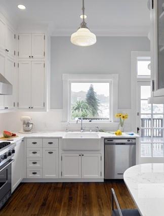 Bungalow kitchen.  White cabs, dark floors, gray walls