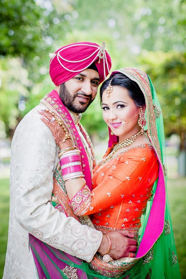 Punjabi bride and groom in pink and orange