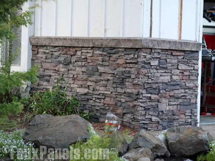 stone veneer panels and siding to cover up the textured cement where the basement begins - Faux Stone Veneer