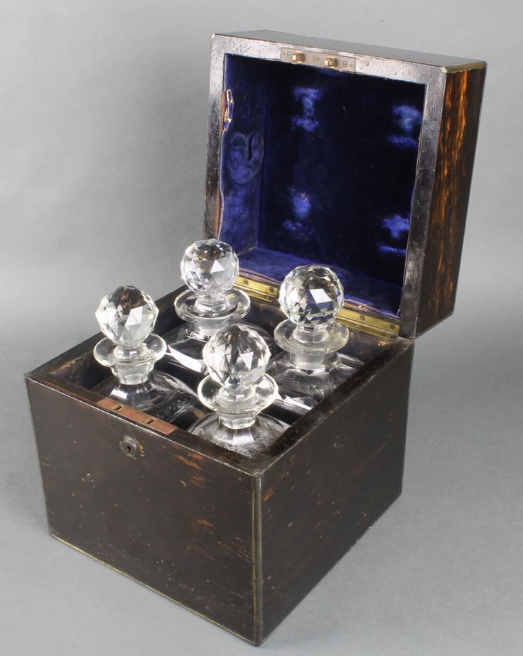 """Lot 791, A Victorian Coromandel and brass mounted decanter box with bramah lock, fitted 4 cut glass decanters 10""""h x 9 1/2"""" x 9 1/2"""", est £100-150"""