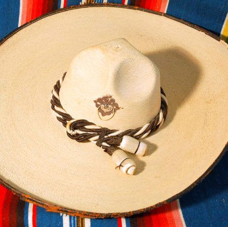 This beautiful vintage Mexican sombrero is palm leaf with black and cream  silken cording hat band