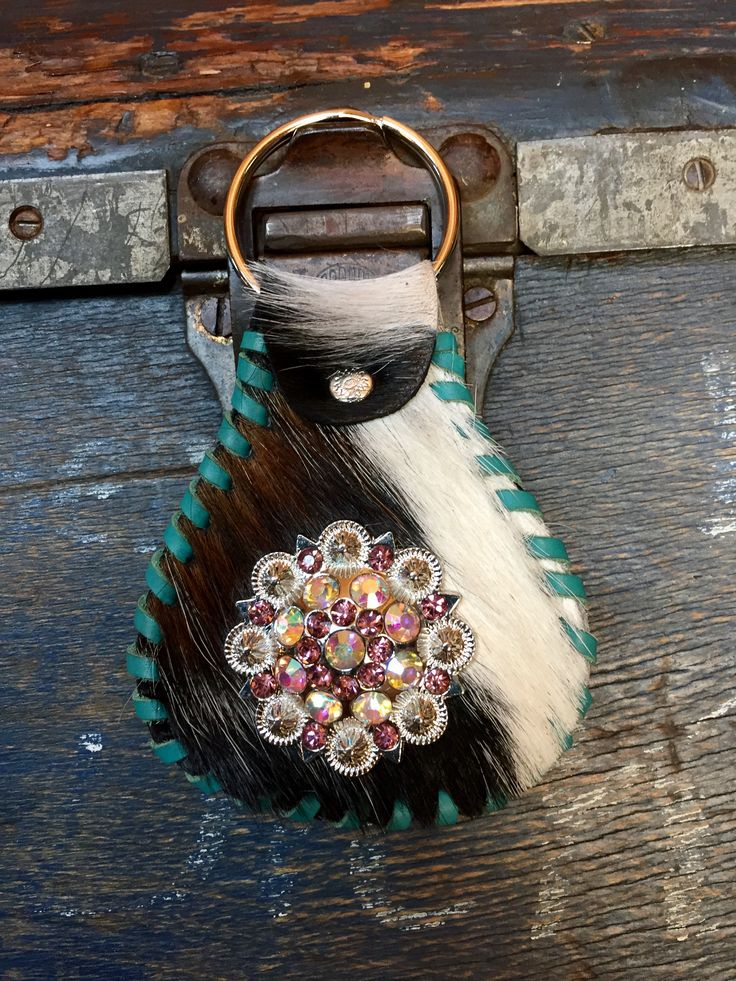 A cowhide key ring with Swarovski crystal concho, stitched in turquoise leather lace. gowestdesigns.us