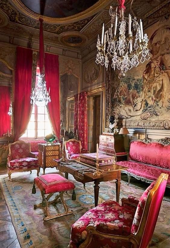 French salon with crimson upholstery and a tapestry.