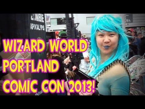 Wizard World Portland Comic Con 2013 #comics http://youtu.be/HuhV9jYoJWo  At the end when the guy is talking you can see the back of me in the pink shirt and my daughter with the pig tails sitting on the steps to your left.
